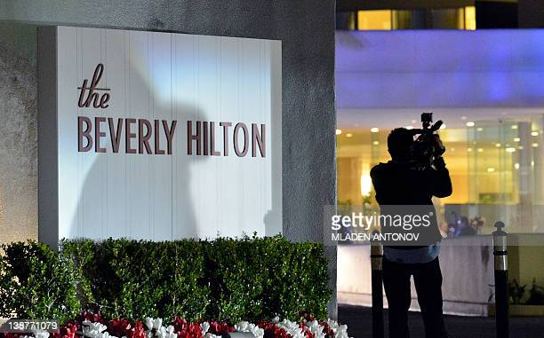 A cameraman shoots views of the Beverly Hilton Hotel a few hours before the scheduled Clive Davis And The Recording Academy's 2012 PreGrammy Gala And...