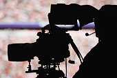 silhoutte of a camera man in a stadium