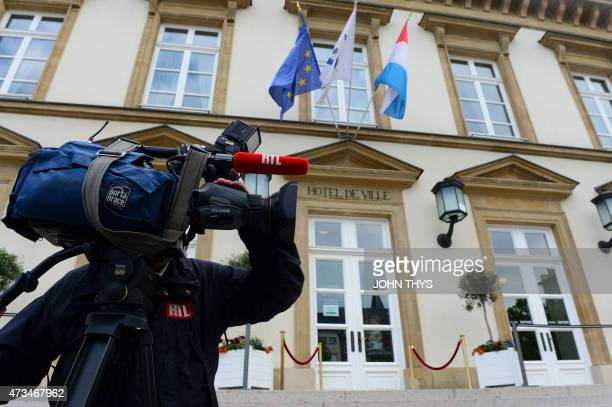 A cameraman stands outside City Hall during the wedding of the prime minister of Luxembourg in Luxembourg on May 15 2015 Luxembourg Prime Minister...