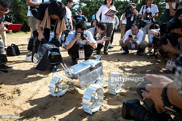 Cameraman take photos of Hakuto's rover PFM3 preflight model which is being tested by team ispace Tohoku University researchers and students in...