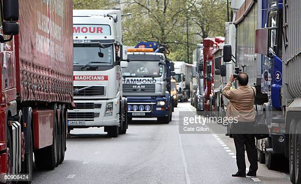 A cameraman takes footage as British road hauliers hold a protest against fuel prices on Park Lane on april 29 2008 in London England Tens of lorries...