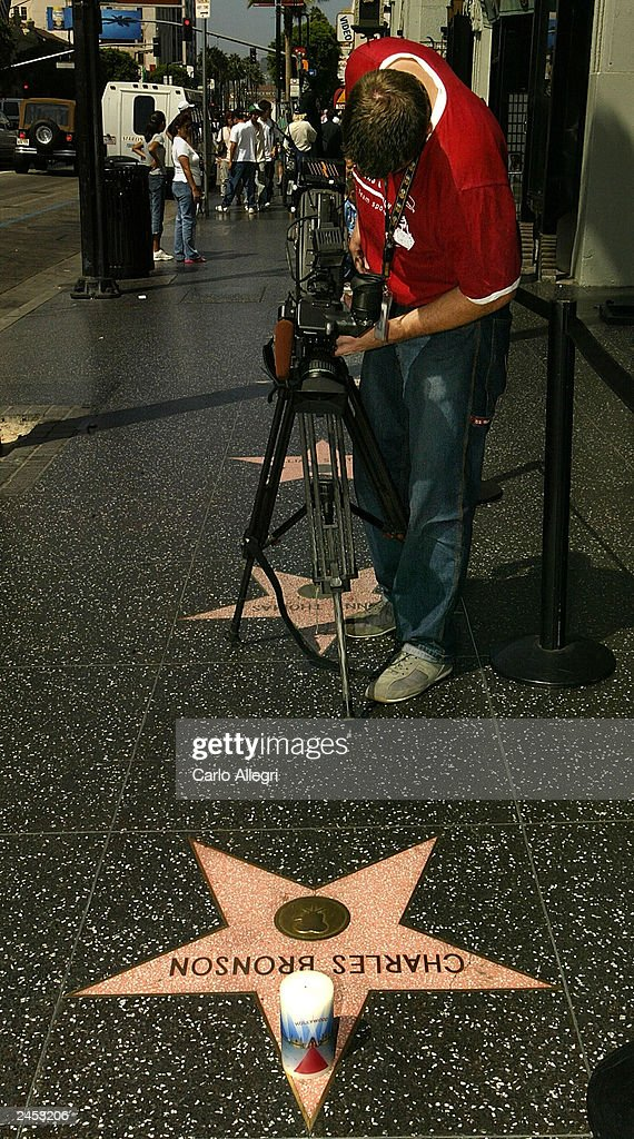 A cameraman tapes the star of actor Charles Bronson on the Hollywood Walk of Fame September 1, 2003 in Hollywood, California. Bronson died of pneumonia at the age of 81 August 30, 2003 in Los Angeles, California.