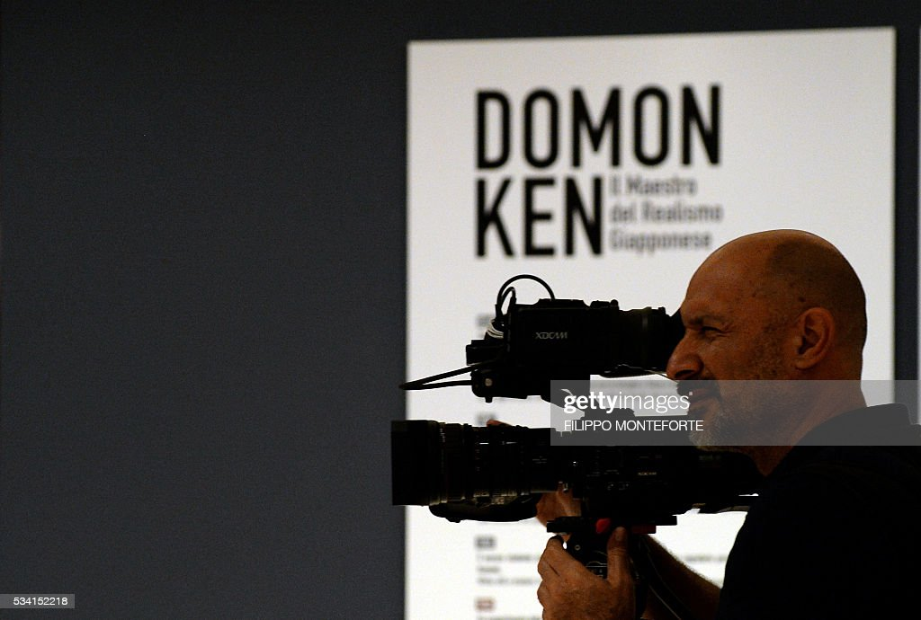 A cameraman works during a press preview of the exhibition of Japanese photographer Domon Ken (1909-1990) at the Ara Pacis Museum (Museo dell'Ara Pacis) on May 25, 2016 in Rome. The show will run from May 27, 2016 to September 18, 2016 to mark 150th years of friendship between Japan and Italy. / AFP / FILIPPO
