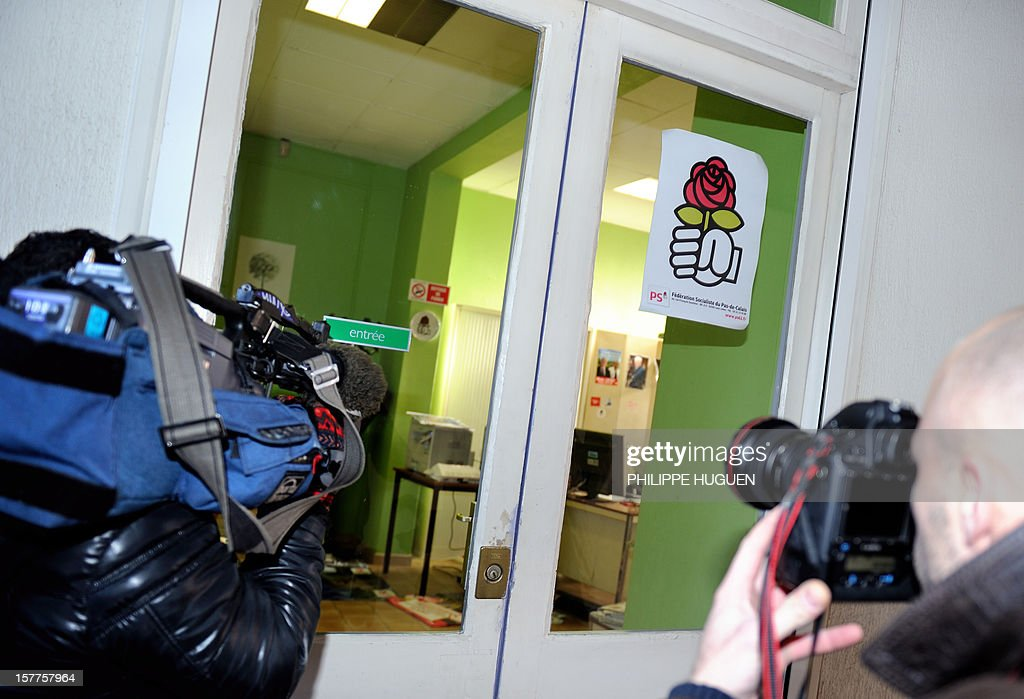 Cameramen film the headquarters of the French socialist party federation of the Pas-de-Calais on December 6, 2012 in Lens, during a search as part of an inquiry into an alleged hidden financing of this federation, involving local MP Jean-Pierre Kucheida.