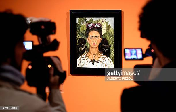 Cameramen film the 'Selfportrait with with Thorn Necklace and Hummingbird' by Mexican artist Frida Kahlo during an exhibition in Rome's Scuderie del...