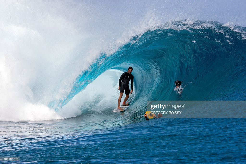 Cameramen float in the water filming Brazil's Gabriel Medina sticking out his tongue before competing in the World Surf league tour n°4 as part of...