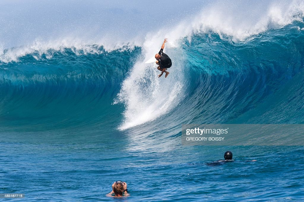 Cameramen float in the water filming USA's Kelly Slater practicing before competing in the World Surf league tour n°4 as part of the 2015 Billabong...