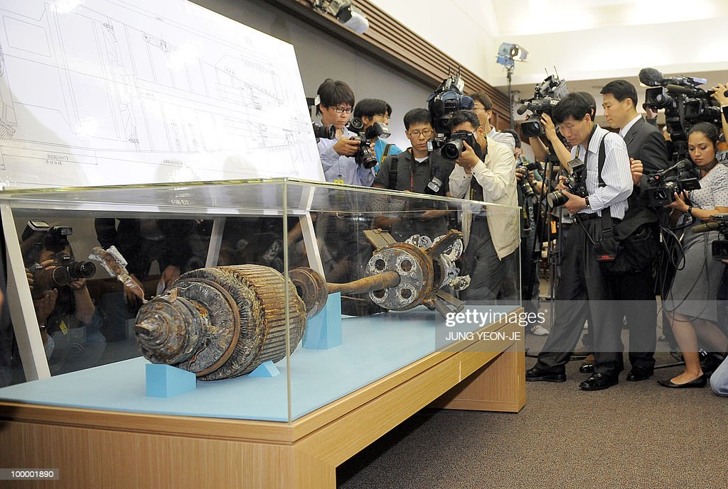 Cameramen take footage of torpedo parts salvaged from the Yellow Sea during a press conference at the Defense Ministry in Seoul on May 20, 2010. South Korea's president vowed 'resolute countermeasures' against North Korea after investigators concluded that it sank one of Seoul's warships with the loss of 46 lives. A multinational team investigating the March 26 sinking of the 1,200-tonne corvette said a torpedo fired by a North Korean submarine was to blame.