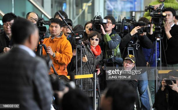 Cameramen take video footage as Ok SungSeok vice chairman of the Corporate Association of Kaesong Industrial Complex talks to the media at the...