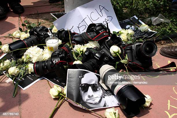 Cameras with banners and flowers are seen during a protest against the murder of the journalist Ruben Espinosa in Veracruz Mexico on August 02 2015...