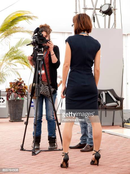 Camerawoman and female reporter conducting an interview between sessions of the United Nations Framework Conference on Climate Change UNFCCC COP20 in...