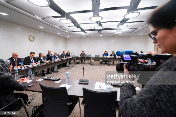 A camerawoman films the Syrian government delegation at the start of a meeting between UN Special Envoy for Syria and Syria's government delegation...