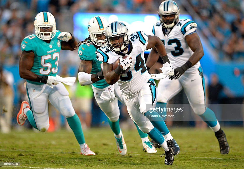 Cameron Artis-Payne #34 of the Carolina Panthers runs against the Miami Dolphins during their preseason NFL game at Bank of America Stadium on August 22, 2015 in Charlotte, North Carolina.