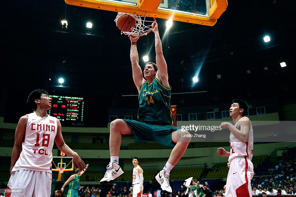 Cameron Bairstow #14 of the Boomers dunks the ball during game three of the series between the Australian Boomers and China at Tianjin Sports Center on June 12, 2013 in Tianjin, China.