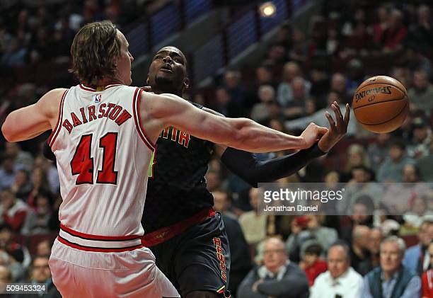 Cameron Bairstow of the Chicago Bulls knocks the ball away from Paul Millsap of the Atlanta Hawks at the United Center on February 10 2016 in Chicago...