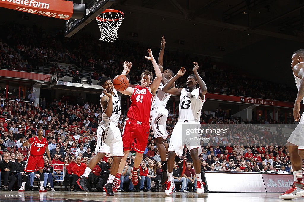 Cameron Bairstow #41 of the New Mexico Lobos rebounds against JaQuon Parker #44 and Cheikh Mbodj #13 of the Cincinnati Bearcats during the game at Fifth Third Arena on December 27, 2012 in Cincinnati, Ohio. New Mexico won 55-54.