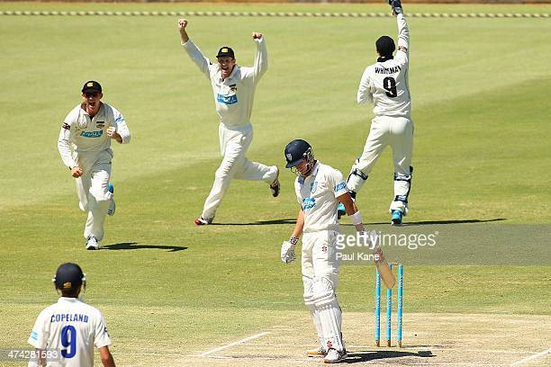 Cameron Bancroft Adam Voges and Sam Whiteman of the Warriors celebrate the dismissal of Sean Abbott of the Blues during day four of the Sheffield...