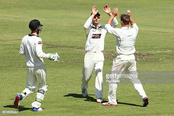 Cameron Bancroft and D'Arcy Short of Western Australia celebrates the wicket of Ben Dunk of Tasmania during day four of the Sheffield Shield match...