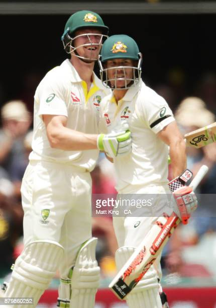 Cameron Bancroft and David Warner of Australia celebrate victory during day five of the First Test Match of the 2017/18 Ashes Series between...