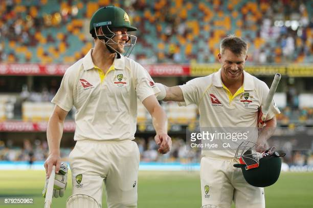 Cameron Bancroft and David Warner of Australia leaves the field at the end of play during day four of the First Test Match of the 2017/18 Ashes...
