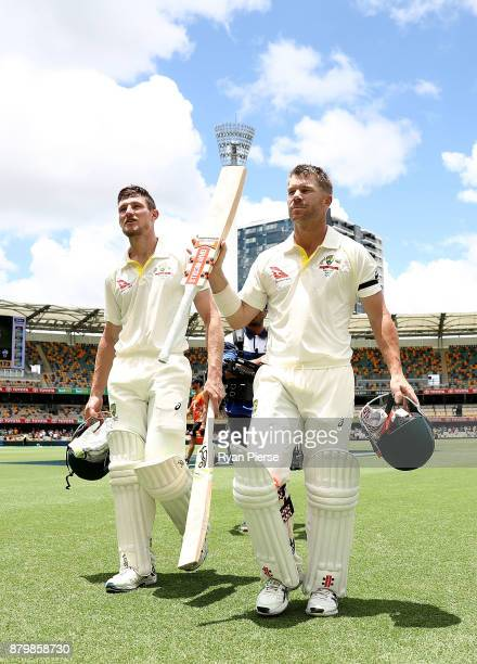 Cameron Bancroft and David Warner of Australia walk from the ground after hitting the winning runs during day five of the First Test Match of the...