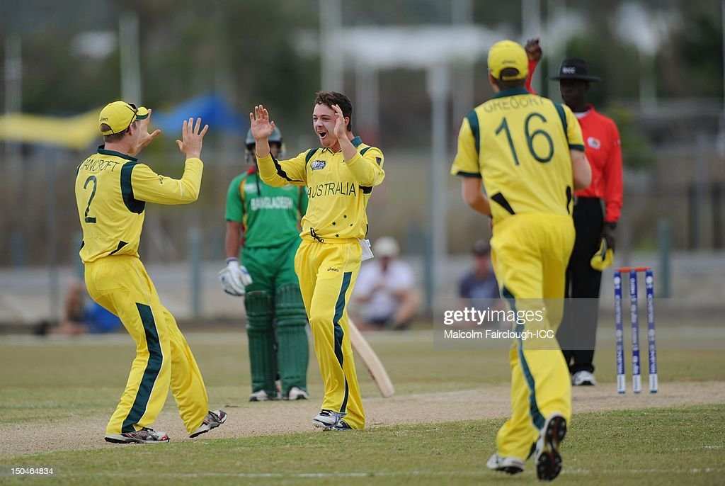 Cameron Bancroft (L) celebrates with Travis Head during the ICC U19 Cricket World Cup 2012 Quarter Final match between Australia and Bangladesh at Endeavour Park on August 19, 2012 in Townsville, Australia.
