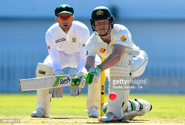 Cameron Bancroft of Australia A plays a sweep shot during the Winter Series between Australia A and South Africa A at Allan Border Field on July 30...