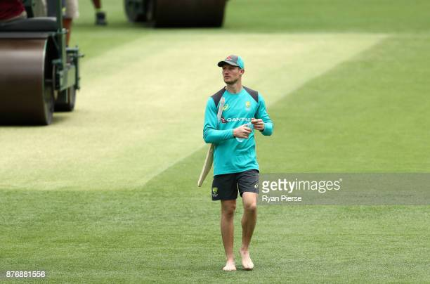 Cameron Bancroft of Australia inspects the pitch during the Australian nets session at The Gabba on November 21 2017 in Brisbane Australia