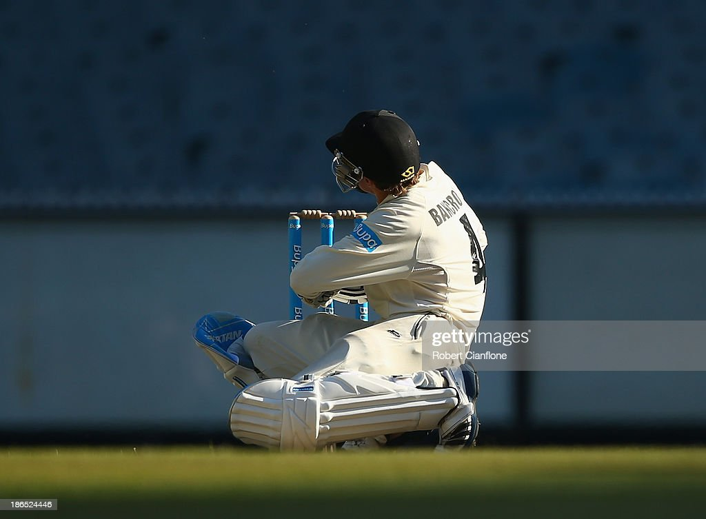 Cameron Bancroft of the Warriors is hit on the helmet by a Peter Siddle bouncer during day three of the Sheffield Shield match between the Victoria Bushrangers and the Western Australia Warriors at Melbourne Cricket Ground on November 1, 2013 in Melbourne, Australia.