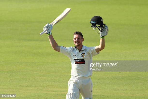 Cameron Bancroft of Western Australia celebrates his century during day one of the Sheffield Shield match between Western Australia and South...