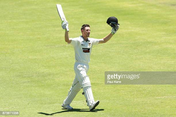 Cameron Bancroft of Western Australia raises his bat to celebrate his double century during day two of the Sheffield Shield match between Western...