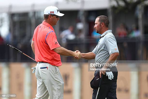 Cameron Beckman congratulates Chad Collins after their round on the 18th during Round Two of the Valero Texas Open at TPC San Antonio ATT Oaks...