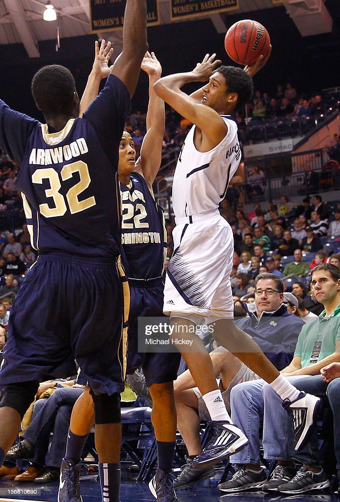 Cameron Biedscheid #1 of the Notre Dame Fighting Irish looks to pass off the ball as Isaiah Armwood #32 of the George Washington Colonials and <a gi-track='captionPersonalityLinkClicked' href=/galleries/search?phrase=Joe+McDonald+-+Basketball+Player&family=editorial&specificpeople=15438261 ng-click='$event.stopPropagation()'>Joe McDonald</a> #22 of the George Washington Colonials defend at Purcel Pavilion on November 21, 2012 in South Bend, Indiana. Notre Dame defeated George Washington 65-48.