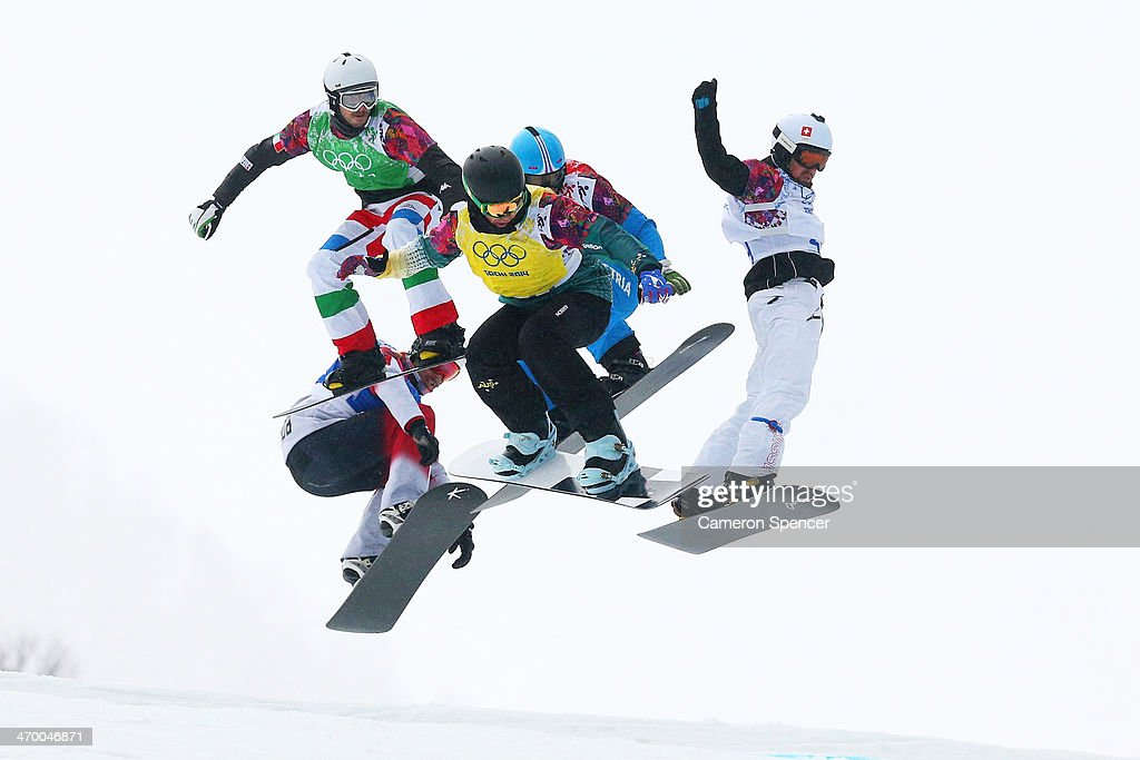 Cameron Bolton of Australia (yellow bib) leads the field in the Men's Snowboard Cross 1/8 Finals on day eleven of the 2014 Winter Olympics at Rosa Khutor Extreme Park on February 18, 2014 in Sochi, Russia.