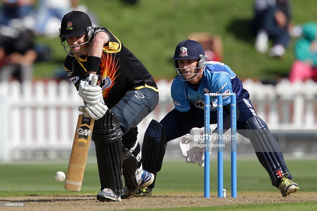 Cameron Borgas of Wellington bats while Gareth Hopkins of Auckland looks on during the HRV Cup Twenty20 Preliminary Final between the Wellington Firebirds and the Auckland Aces at Basin Reserve on January 18, 2013 in Wellington, New Zealand.