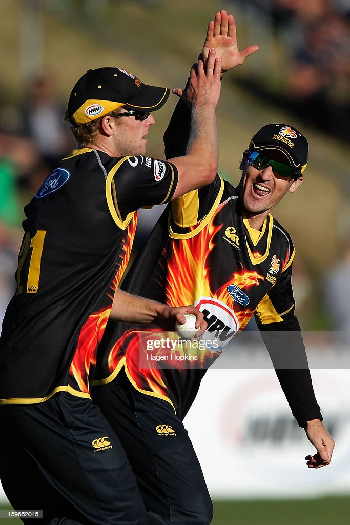 Cameron Borgas of Wellington congratulates Harry Boam after taking the wicket of Andre Adams of Auckland during the HRV Cup Twenty20 Preliminary Final between the Wellington Firebirds and the Auckland Aces at Basin Reserve on January 18, 2013 in Wellington, New Zealand.