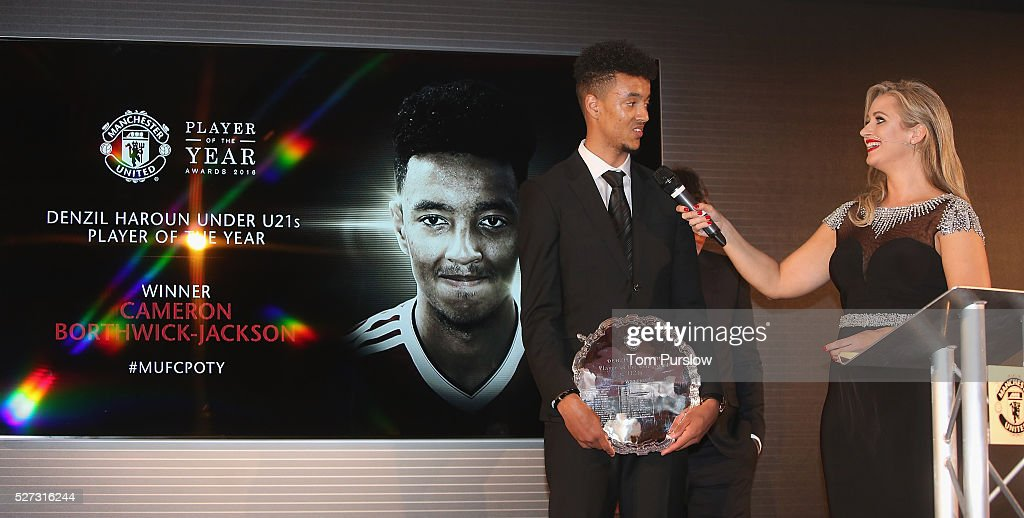 <a gi-track='captionPersonalityLinkClicked' href=/galleries/search?phrase=Cameron+Borthwick-Jackson&family=editorial&specificpeople=11316628 ng-click='$event.stopPropagation()'>Cameron Borthwick-Jackson</a> of Manchester United is interviewed by host <a gi-track='captionPersonalityLinkClicked' href=/galleries/search?phrase=Hayley+McQueen&family=editorial&specificpeople=9513992 ng-click='$event.stopPropagation()'>Hayley McQueen</a> at the club's annual Player of the Year awards at Old Trafford on May 2, 2016 in Manchester, England.