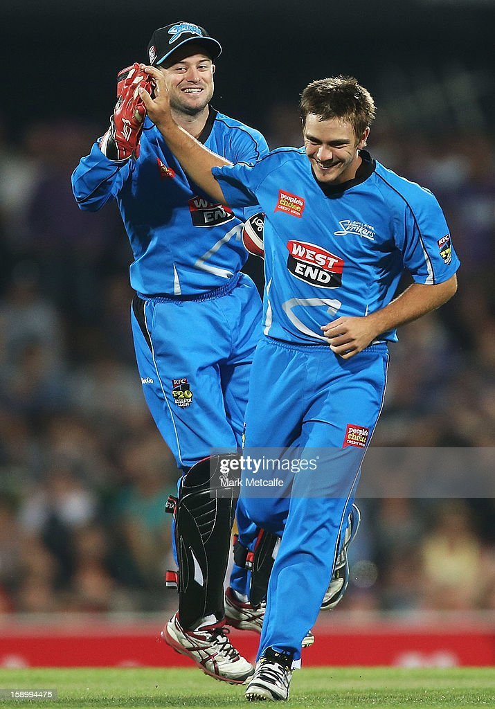 Cameron Boyce and Tim Ludeman of the Strikers celebrate the wicket of Ricky Ponting of the Hurricanes during the Big Bash League match between the Hobart Hurricanes and the Adelaide Strikers at Blundstone Arena on January 5, 2013 in Hobart, Australia.