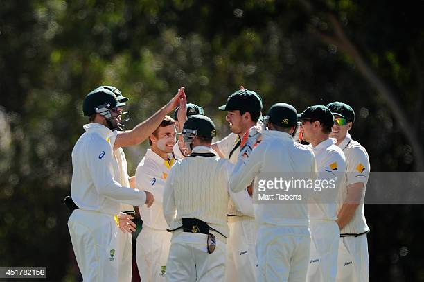 Cameron Boyce of Australia A celebrates a wicket with teammates during the Quadrangular Series match between Australia A and India A at Allan Border...