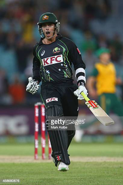Cameron Boyce of Australia celebrates victory during game three of the Men's International Twenty20 series between Australia and South Africa at ANZ...