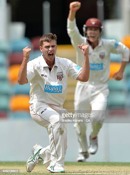 Cameron Boyce of Queensland celebrates after taking the wicket of Nathan Lyon of New South Wales during day four of the Sheffield Shield match...