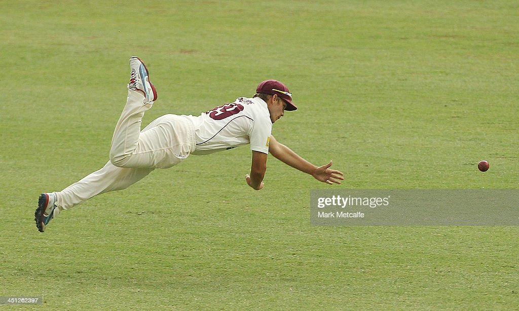 Cameron Boyce of the Bulls dives in the field during day one of the Sheffield Shield match between the New South Wales Blues and the Queensland Bulls at Sydney Cricket Ground on November 22, 2013 in Sydney, Australia.