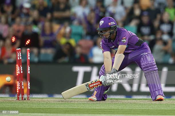 Cameron Boyce of the Hurricanes is bowled by Pat Cummins of the Thunder during the Big Bash League match between the Hobart Hurricanes and the Sydney...