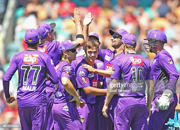 Cameron Boyce of the Hurricanes is congratulated by his teammates after dismissing Michael Carberry of the Scorchers during the Big Bash League match...