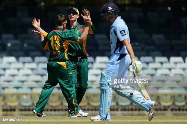 Cameron Boyce of the Tigers celebrates after taking the wicket of Daniel Hughes of the Blues during the One Day Cup match between New South Wales and...