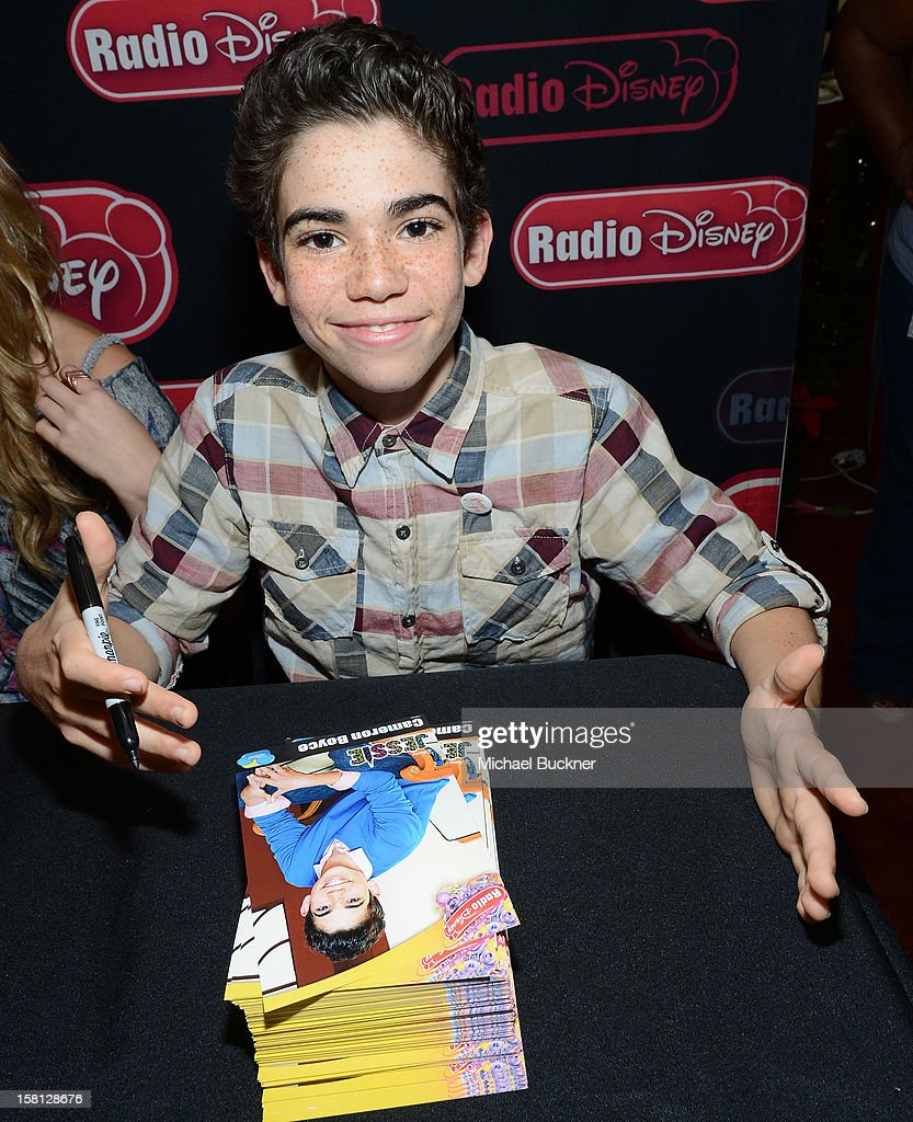 Cameron Boyce star of the hit series 'Jessie' gets signs autographs for Radio Disney AM 1110 fans at the Wii U Showdown at Westfield Century City Mall in Los Angeles on December 9, 2012. Wii U is one of Nintendo's hottest items of the holiday season.