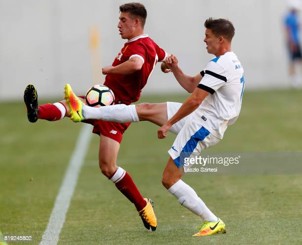 Cameron Brannagan of FC Liverpool U23 competes for the ball with Martin Nagy of MTK Budapest II during the Preseason Friendly match between MTK...