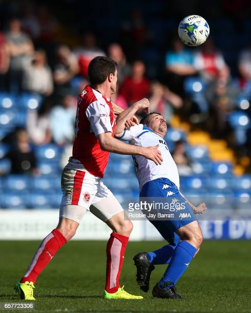 Cameron Brannagan of Fleetwood Town and Paul Caddis of Bury during the Sky Bet League One match between Bury and Fleetwood Town at Gigg Lane on March...