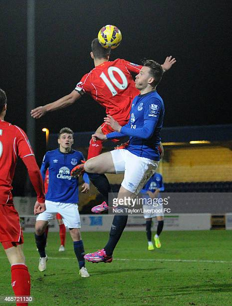 Cameron Brannagan of Liverpool and Gethin Jones of Everton in action during the U21 Premier League match between Liverpool and Everton at The...