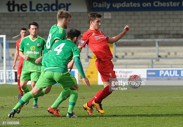 Cameron Brannagan of Liverpool and Martin Smith and Liam Agnew of Sunderland in action during the Liverpool v Sunderland Barclays U21 Premier League...